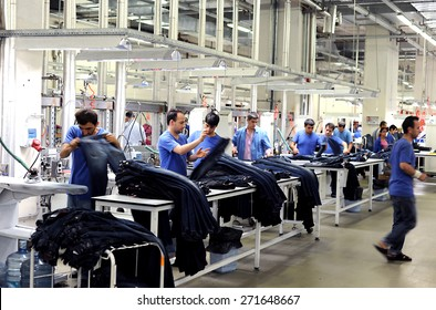 Turkey textile industry,July 24, 2014. Textile is very important sector for turkish economy. At the same time this sector is generating  employment. The workers are seen on the picture in a factory
