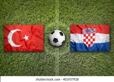 Turkey vs. Croatia flags on green soccer field
