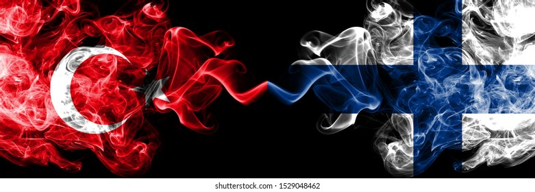 Turkey vs Finland, FInnish smoke flags placed side by side. Thick colored silky smoke flags of Turkish and Finland, FInnish
