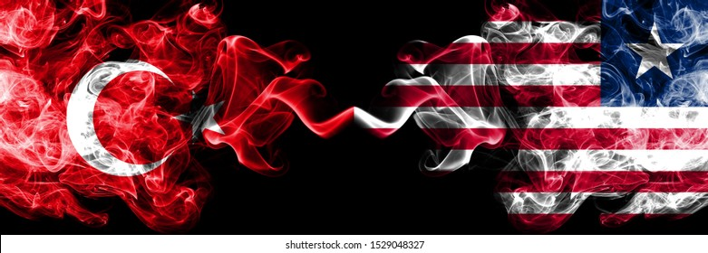Turkey vs Liberia, Liberian smoke flags placed side by side. Thick colored silky smoke flags of Turkish and Liberia, Liberian