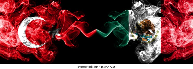 Turkey vs Mexico, Mexican smoke flags placed side by side. Thick colored silky smoke flags of Turkish and Mexico, Mexican