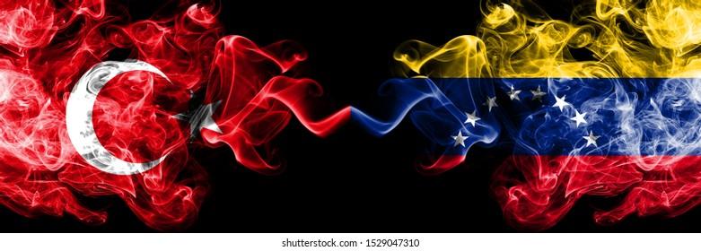 Turkey vs Venezuela, Venezuelan smoke flags placed side by side. Thick colored silky smoke flags of Turkish and Venezuela, Venezuelan