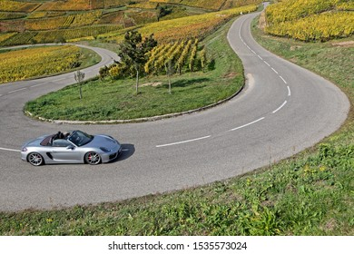 TURKHEIM, FRANCE, October 12, 2019 : On the roads of the Route des Vins of Alsace in sport cars, through a landscape of vineyards.