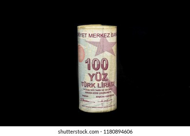 Turkish 100 Lira Banknote Isolated on black. Turkey's lira crisis. Turkish lira is going down. Turkish lira growing up. Turkish economy plunges, crashing. Inflation, debt and tariffs