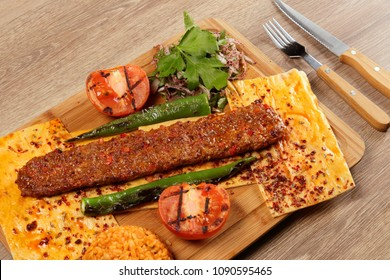 Turkish Adana Kebab on the Wood Plate