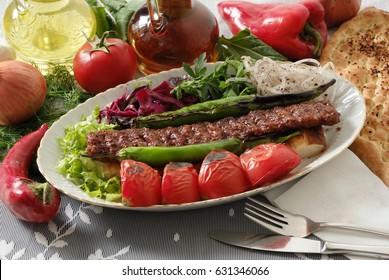 Turkish Adana Kebap garnished with vegetables