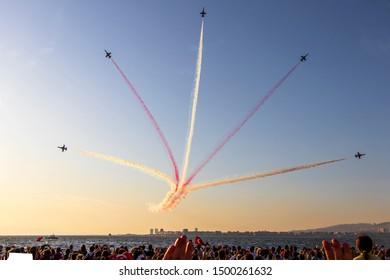 İZMİR, TÜRKİYE: Turkish Air Force aerobatic demonstration team which called Turkish Stars are flying on the sky for 9 September- Izmir's Independence Day, Izmir,Turkey- September 9, 2019