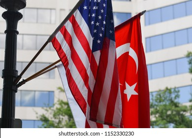 Turkish and american national flags on an flagpole