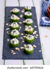 Turkish Appetizer Yogurt and Cucumber slices (Haydari)  with almond flakes