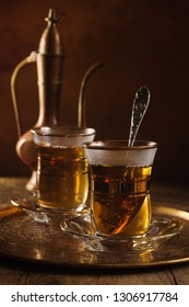 Turkish apple tea or Elma Cayi a fruit flavoured beverage served in Turkish glasses lit with creative lighting
