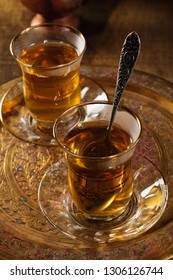 Turkish apple tea an apple flavoured beverage served in Turkish tea glasses lit with creative lighting