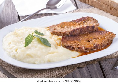 Turkish and arabic traditional meal potato mash and roast meat loaf , rosto kofte