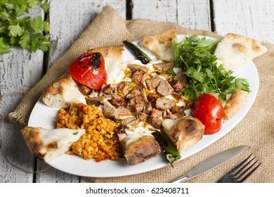 Turkish and Arabic Traditional Ramadan Kebab Ali Nazik on white rustic wood background.