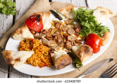 Turkish and Arabic Traditional Ramadan Kebab Ali Nazik on white rustic wood background.