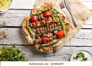 Turkish and Arabic Traditional Ramadan Mix Vali Kebab Plate inside Adana, Urfa, Chicken, Lamb, Liver and Beef on bread and lahmacun.