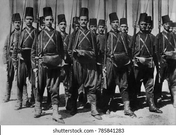 Turkish army c. 1910-1913, in traditional uniforms. They have baggy pants, tunics worn under a short jacket, and the classic fez. Under the influence of their WW1 ally, Germany, these were abandoned f