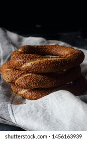 Turkish bagel simit on a black background, still life Turkish bagel simit