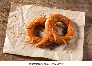 Turkish bagel simit on packing paper and wooden table