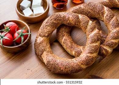 Turkish Bagel Simit with tea, cheese and cherry tomatoes.