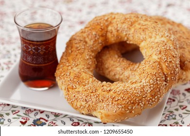 Turkish bagel simit, and traditional Turkish tea closeup