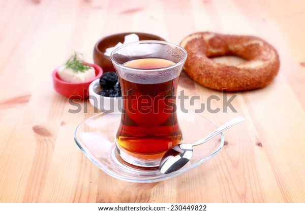 Turkish bagel, simit, and traditional tea on a table