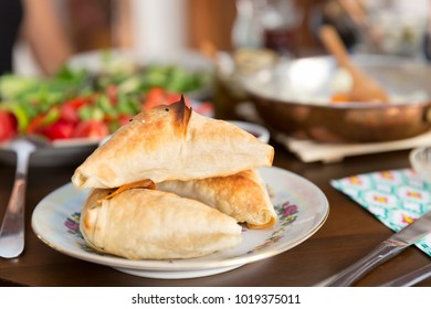 Turkish and Balkans Traditional Puff pastry with meat or cheese. Samosa or Muska Boregi  is a family of baked filled pastries made of a thin flaky dough known as phyllo or yufka of Anatolian origins.