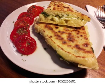Turkish Bazlama Tost / Toast Sandwich with Pesto Sauce and Cherry Tomatoes. FastFood.