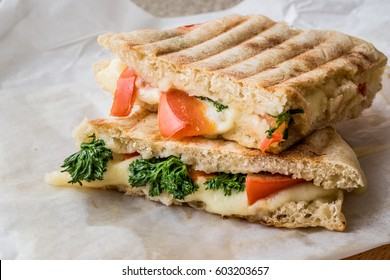 Turkish Bazlama Tost / Toast sandwich with melted cheese, tomatoes and dill