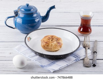 turkish borek boyoz with egg and tea on wooden background