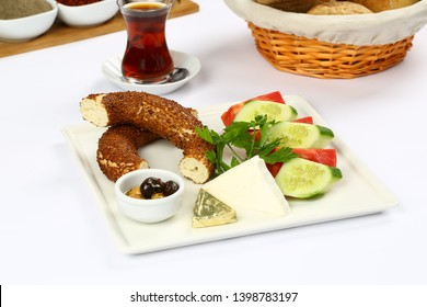 Turkish breakfast with Bagel, simit and cheese, olive, tomatoes, cucumber,