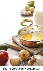 Turkish breakfast with egg in copper pan