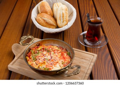 Turkish Breakfast Menemen or Scrambled Eggs with Tomato Paste, pepper, cheese and beef bacon.