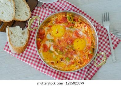 Turkish Breakfast Menemen or Scrambled Eggs with Tomato , pepper, cheese