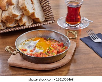 Turkish Breakfast Menemen or Scrambled Eggs with Tomato Paste, pepper, cheese and beef bacon
