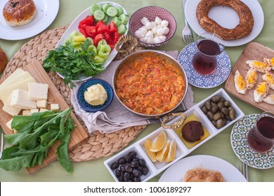 Turkish breakfast with a lot of vegetables, eggs and pastry