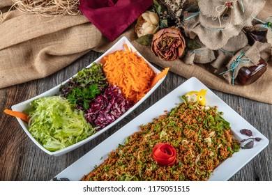 Turkish Bulgur Salad and green salad  - Kisir .
