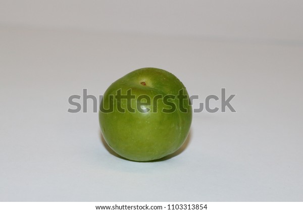 Turkish can erik. Fresh green plum fruit isolated on white. Green and delicious sour plum. Popular spring fruit in middeleast.