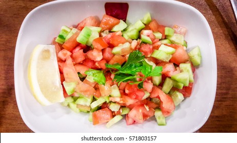 Turkish Coban (choban) salata or Shepherds salad in white bowl.