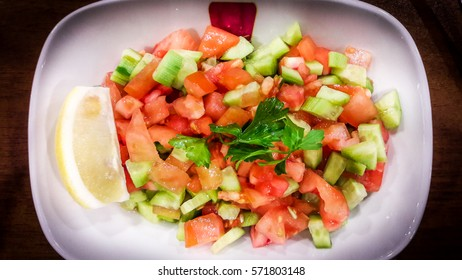 Turkish Coban salata or Shepherds salad in white bowl.
