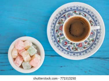 turkish coffee and turkish delights on wooden back ground