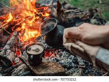 Turkish coffee making process on campfire