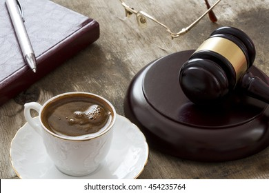 Turkish coffee and mallet of justice on wooden table. Law concept, gavel