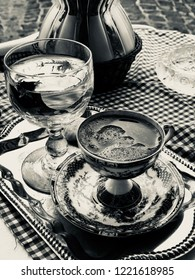 Turkish coffee on vichy pattern tablecloth, black and white photograph, vintage concept, vichy check