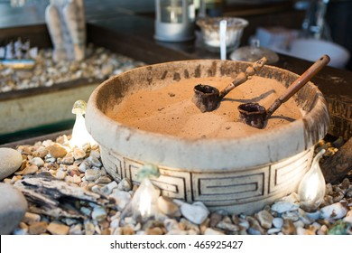 turkish coffee prepared on hot sand. Coffee preparation concept.