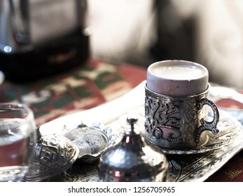 Turkish coffee served with custom made metal coffee cups and porcelain cups