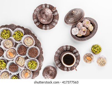 Turkish coffee served with dates covered by mix nuts.