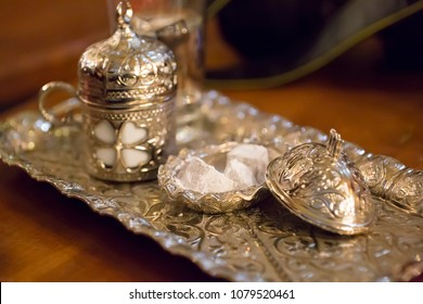 Turkish coffee served with Turkish delights in traditional cups. Selective focus