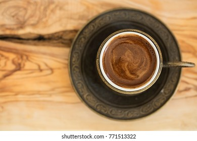 turkish coffee served in a traditional cup on wooden back ground