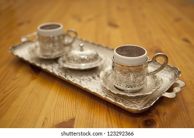 Turkish coffee served in  traditional Turkish cups and tray