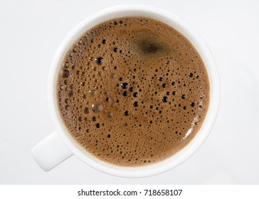 Turkish coffee from top over white background.